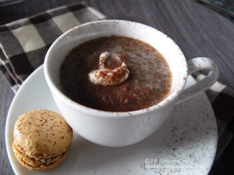 mushroom cappuccino with a truffle macaron