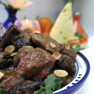 prune tagine of chicken or turkey with toasted almonds and cone of semolina in background